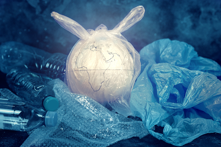 The concept of World Environment Day. The earth in a plastic bag. Imagens