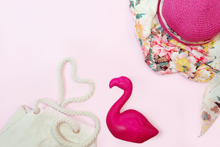 Tropical summer background with flamingo decor. View from above. Flat lay