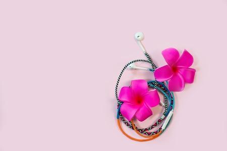 Multicolored earphones top view summer music concept