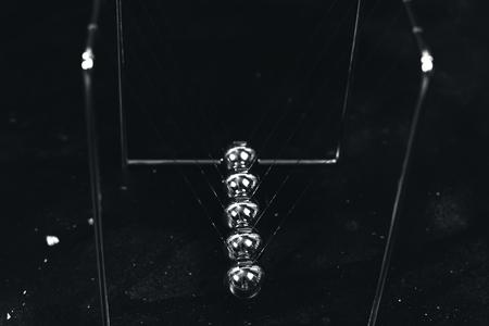 Newton cradle pendulums kinetic balls