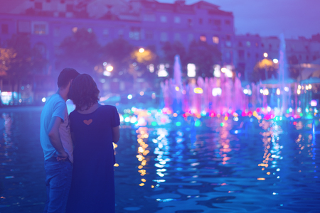 Two people enjoying evening city lights in Tirana Stock Photo