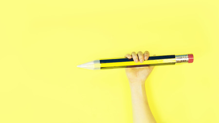 a giant pencil and a little ordinary pencil