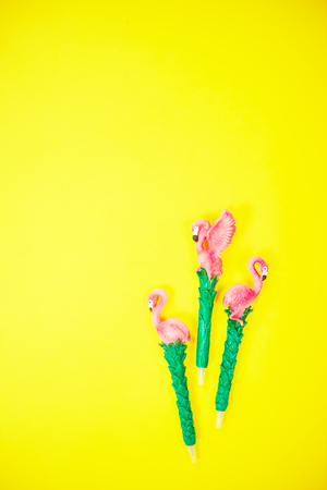 flamingo on vibrant yellow background top view Reklamní fotografie