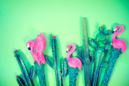 flamingo on vibrant colors background top view