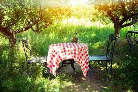 Table is set and waiting for dining in the countryside 스톡 콘텐츠