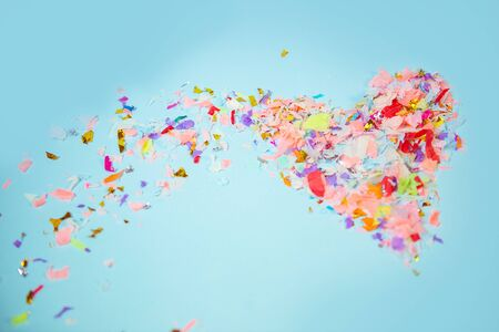 Colorful confetti in the form of a heart. Background, texture. Reklamní fotografie