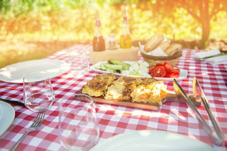 Table is set and waiting for dining in the countryside Stock Photo