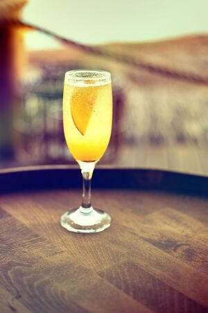 Refreshing orange Mimosa cocktail with champaigne