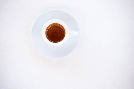 cup of espresso coffee over white background