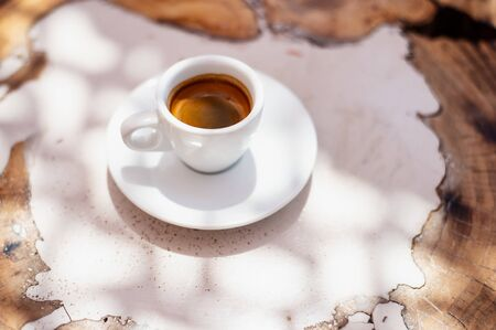 top view a cup of espresso coffee on wooden table background Zdjęcie Seryjne
