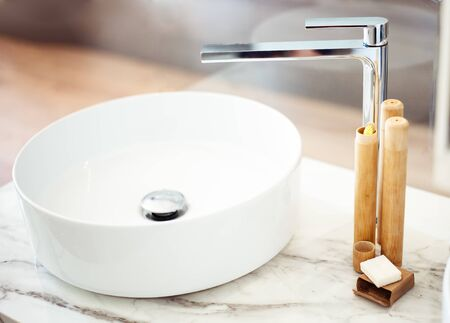 Bamboo toothbrushes on a shelf in the bathroom. Zero waste, eco, save planet Stock Photo