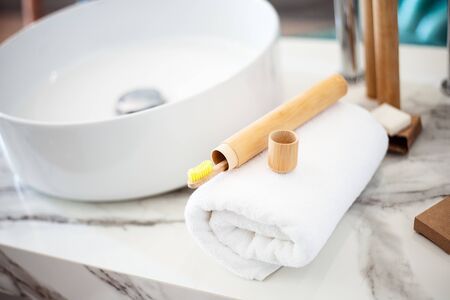 Bamboo toothbrushes on a shelf in the bathroom. Zero waste, eco, save planet Zdjęcie Seryjne - 129255136