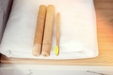 Bamboo toothbrushes on a shelf in the bathroom. Zero waste, eco, save planet Stok Fotoğraf - 129255135