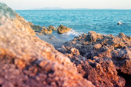 Rocky beach and crystal turquoise water of Ionian Sea in Albania. Calm and relaxing view