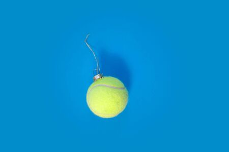 tennis ball ornament over blue hard court background Фото со стока - 129325088