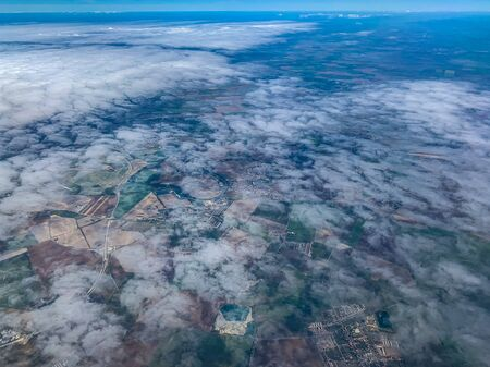 aerial view of village landscape near Budapest over clouds
