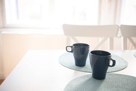 Two cups of coffee in white kitchen