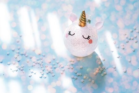 Pink glitter unicorn with gold horn Christmas tree ornament.Magic surreal style. Zdjęcie Seryjne