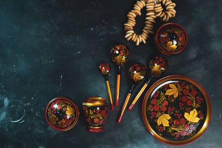 Russian khokhloma, traditional wood painting handicraft souvenirs top view Stock fotó