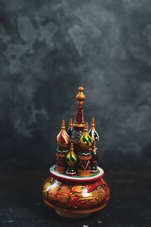 Russian khokhloma, traditional wood painting handicraft souvenirs on black background