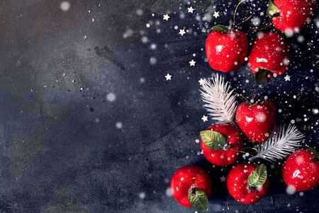 Christmas background with red apples festive decoration