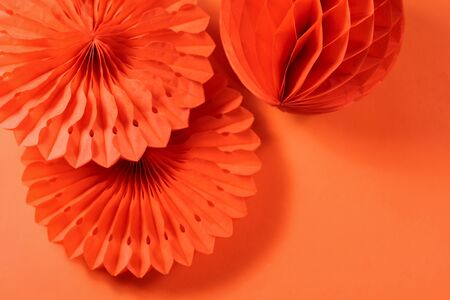 paper fans and honeycombs on the orange background