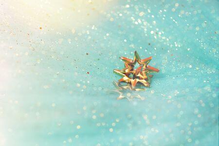 Golden stars glitter on pastel background. Festive holiday astrological concept