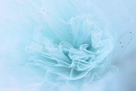 Feminine turquoise fabric tutu tulle skirt close up texture background with golden glitter Banco de Imagens