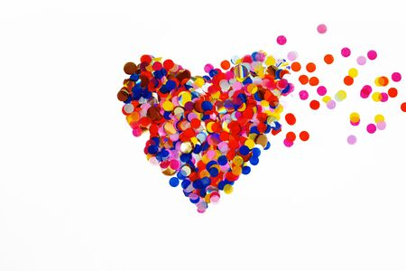 Colorful celebration confetti background pastel colors with copy space top view heart shape valentines day concept