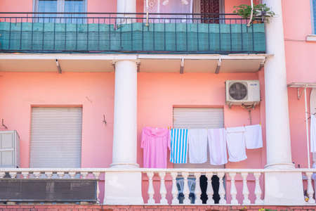 Colourful building facade in Tirana Albania. clothes hanged on the balcony 新闻类图片