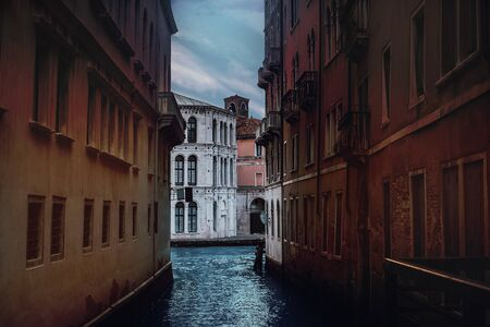 canal in Venice, Italy. Scenic architecture view colorful brick facade