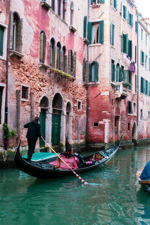 Venice, Italy. March 2019: Gondolas and canals tourists enjoying boat trip