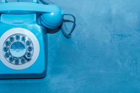 Retro blue telephone close up with place for text top view 免版税图像