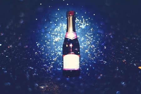 Flat lay of celebration. Champagne bottle bokeh background. 免版税图像