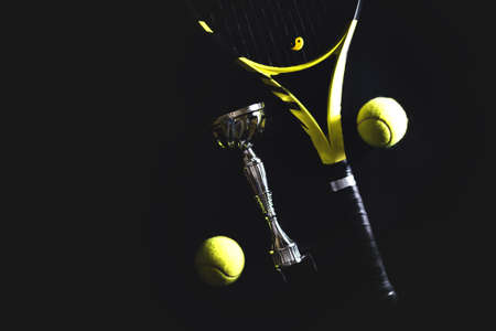 sport fitness equipment. Top view tennis racquet balls and silver cup