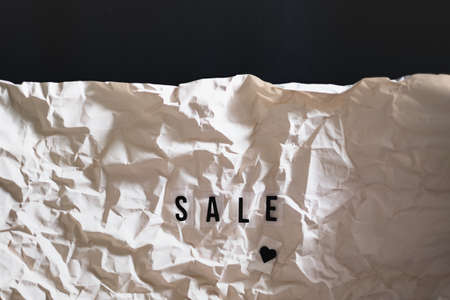 letters text sale on wrapped paper