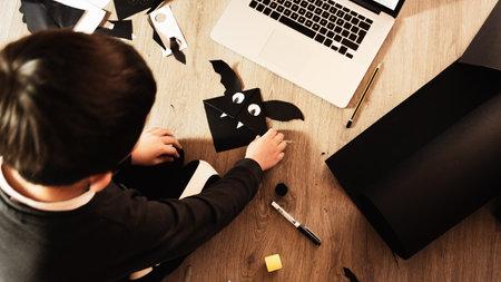 Halloween bat bookmark children art project. DIY concept.