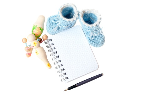 bootee: baby bootee with notepad pen and rattle Stock Photo