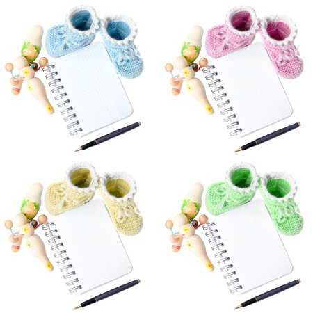 baby bootee with notepad pen and rattle photo