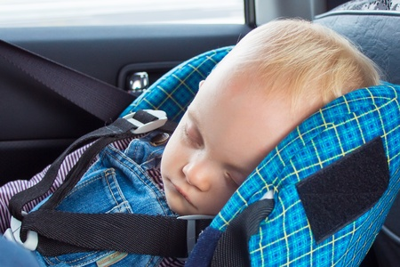 Little baby sleeping in a car seat Stock Photo - 15618741