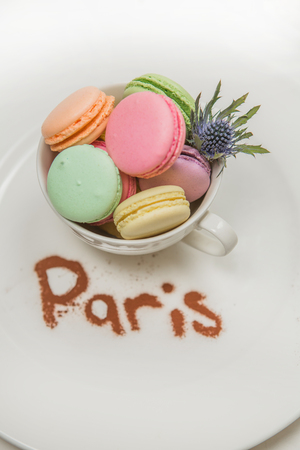 macaroons on a plate with a mountain inscription Stock Photo