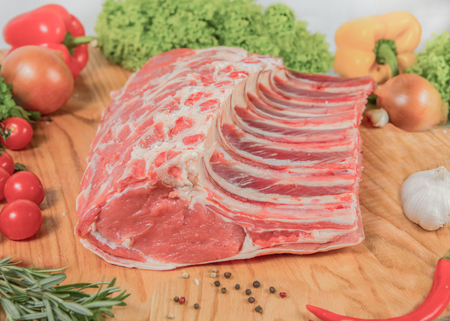 Juicy raw meat, beef entrecote on black background, top view, close up.