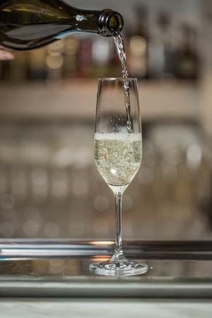 Man pours champagne in wineglasses, ice Banco de Imagens