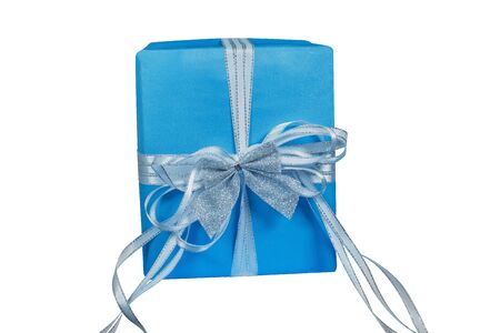 A box sealed with beautiful blue sky-blue paper and tied with a white ribbon and a small silver bow on top of an isolated white background