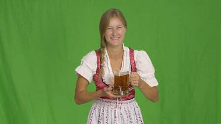 Smiling girl with beer on green.Oktoberfest.
