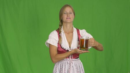 Girl with beer glass on green.Oktoberfest