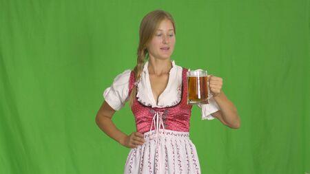 Girl wiht mug of beer on green. Oktoberfest