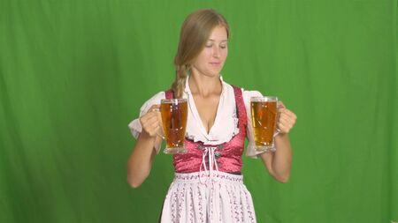 Girl puts two glasses of beer. 版權商用圖片