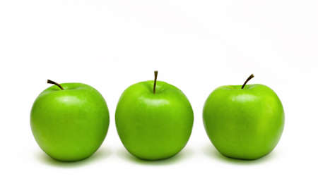 grannies: three delicious fresh green granny smith apples isolated on a white background Stock Photo
