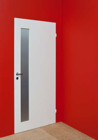ruby house: White door and red wall Stock Photo